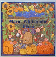 Marie Whitcombe Plaza sign