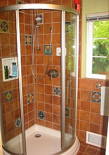 Tile shower with tile inlays