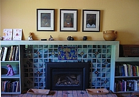 Folk art mermaid fireplace